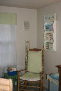 Rocking chair cushions, windown panel above sheers, and the awesome Pottry Barn book shelf.