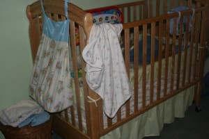 Diaper holder and crib bedding.